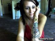 Horny tatooed teen teasing the web cam